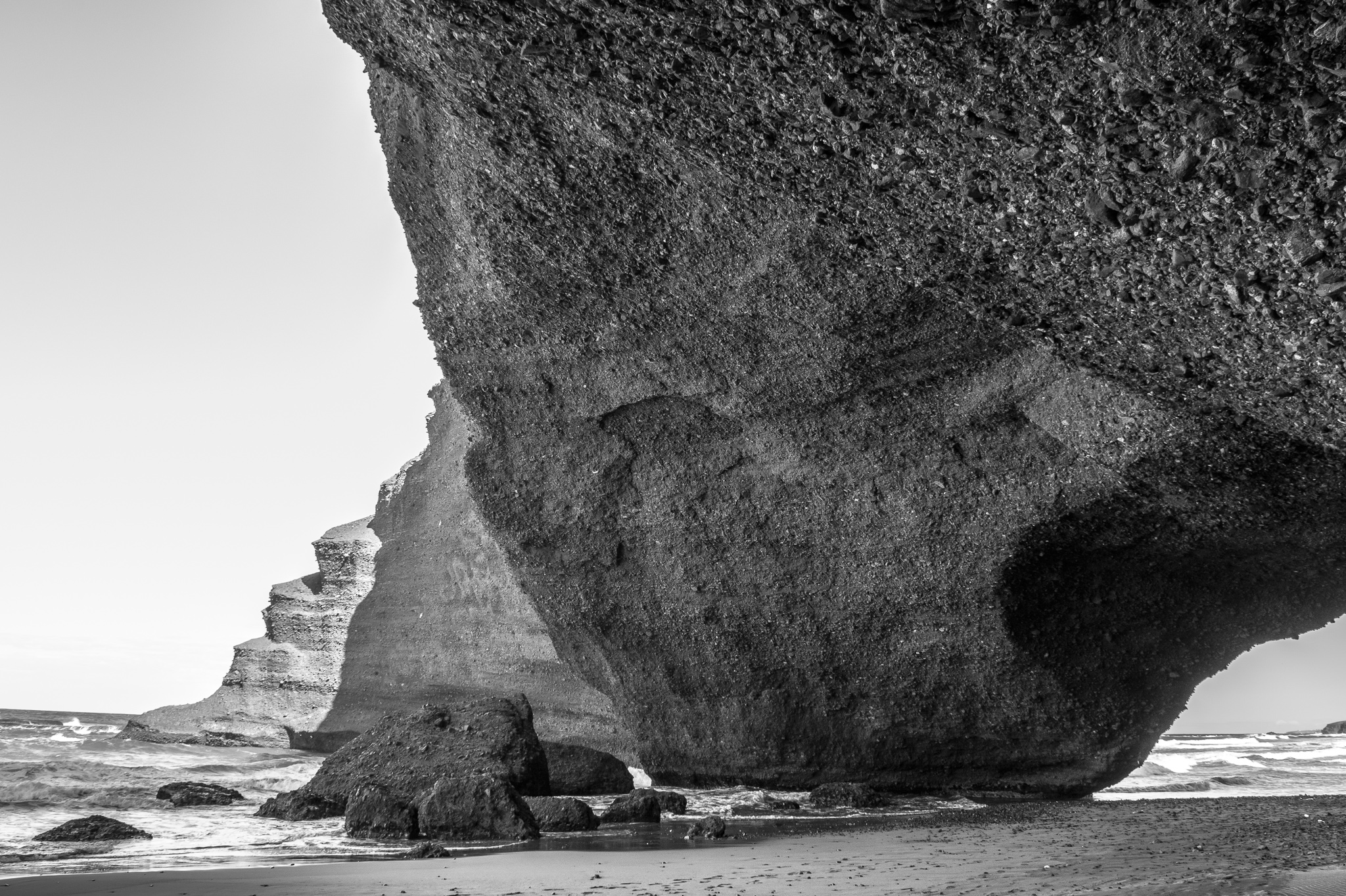 The beach of Legzira is located about 10 km north of the village of Sidi Ifni, the former Spanish colony of Morocco. <br> Its monumental natural bridges, red stone arches and elephant's foot, have been carved by marine erosion for centuries. <br> Recently, in 2016, after a cracking collapsed one of the most emblematic arches of the beach.