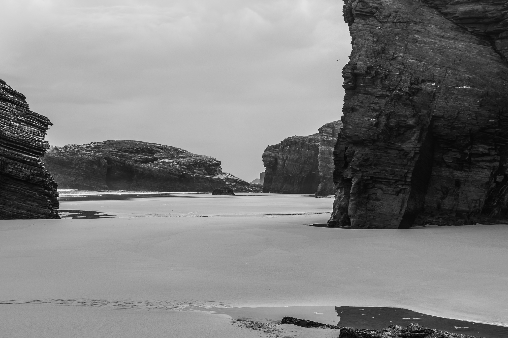 The Beach of the Cathedrals (Beach of Augas Santas), located in the municipality of Ribadeo, is a group of cliffs of about 30m height located at the edge of the sea, that conform a landscape and a beach declared Natural Monument. Visible only at low tide, it shows its arches, grottos and sand corridors at the foot of an area of slate cliffs, while at high tide the water covers all of the sand.