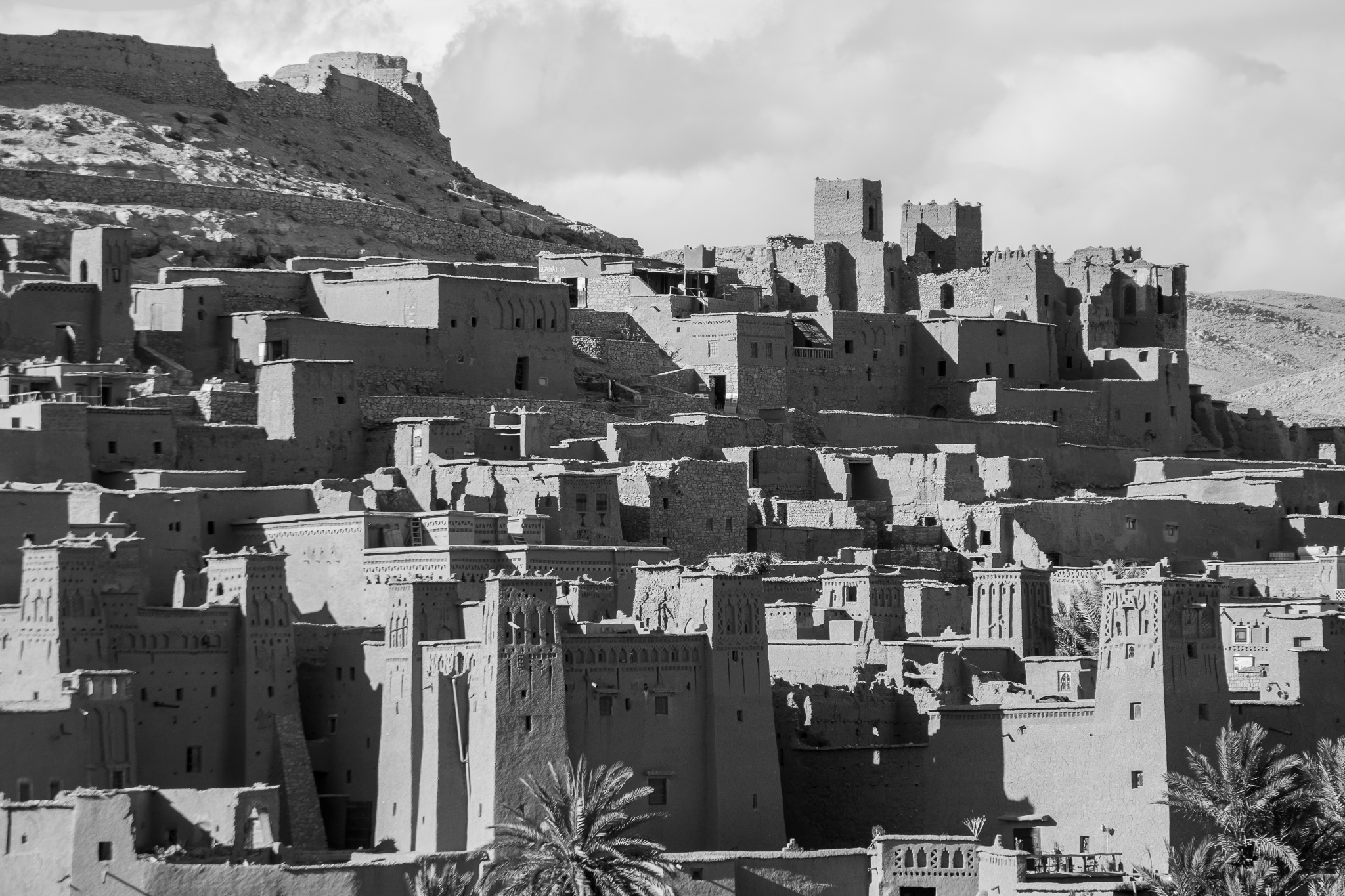 [Kasbah; Alcazaba, citadel.]<br>The Kasbah or Ksar of Ait Ben Haddou is a fortified city in the province of Ouarzazate.<br> It is a spectacular village, of Berber origin, built with clay, stone, and straw, and is one of the best preserved Kasbahs in whole Morocco.