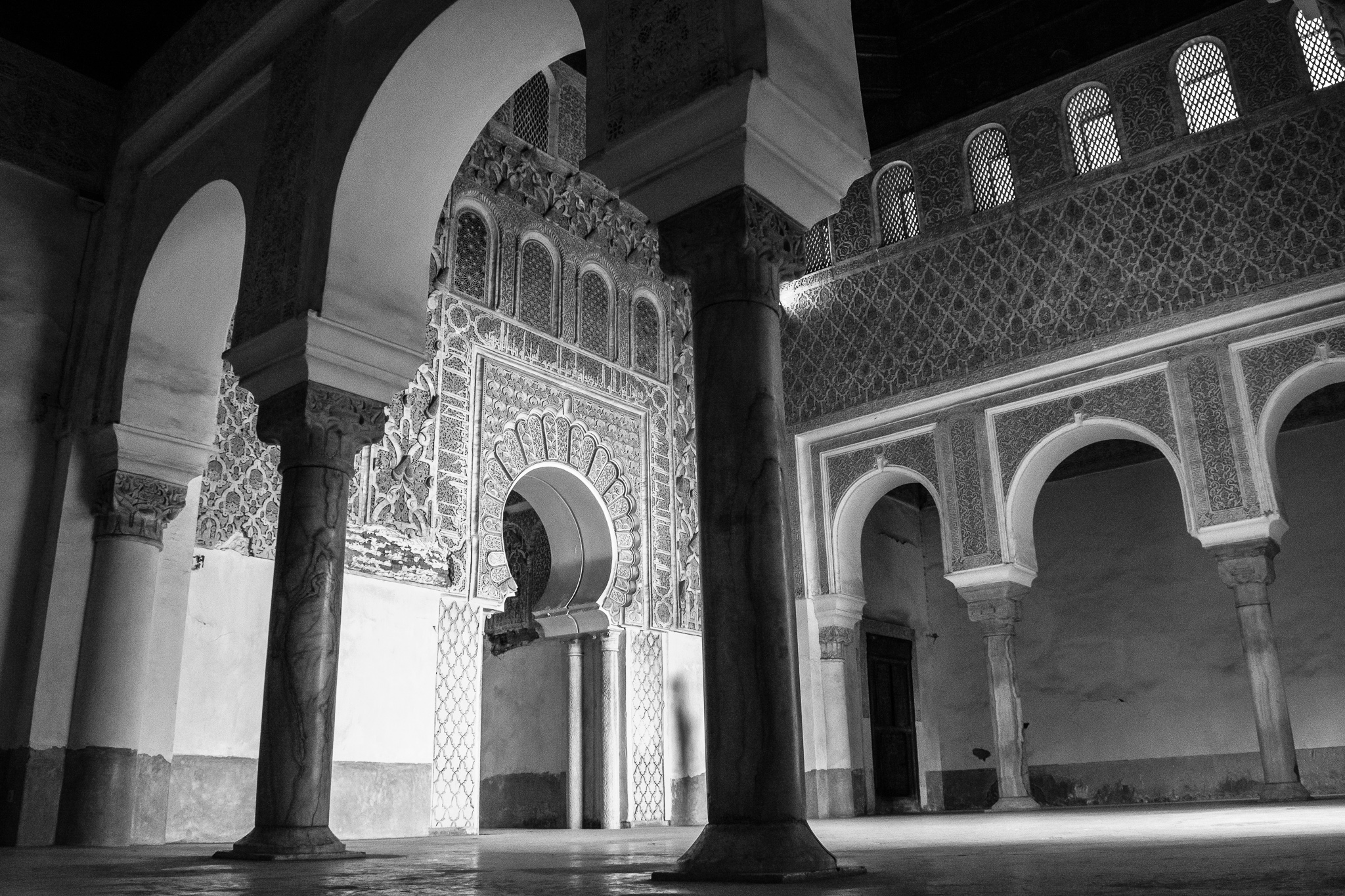 [Madrasa; Muslim school of higher education. Specialized in religious studies.]<br> The Medersa Ben Youssef, also called Madrasa Ben Youssef, founded in the XIV century, is the most important madrasa of Marrakesh. <br>Characterized by its arabe-andalusian architecture, and by its numerous inscriptions in stucco and tiles, its 130 cells had space for up to 900 students.