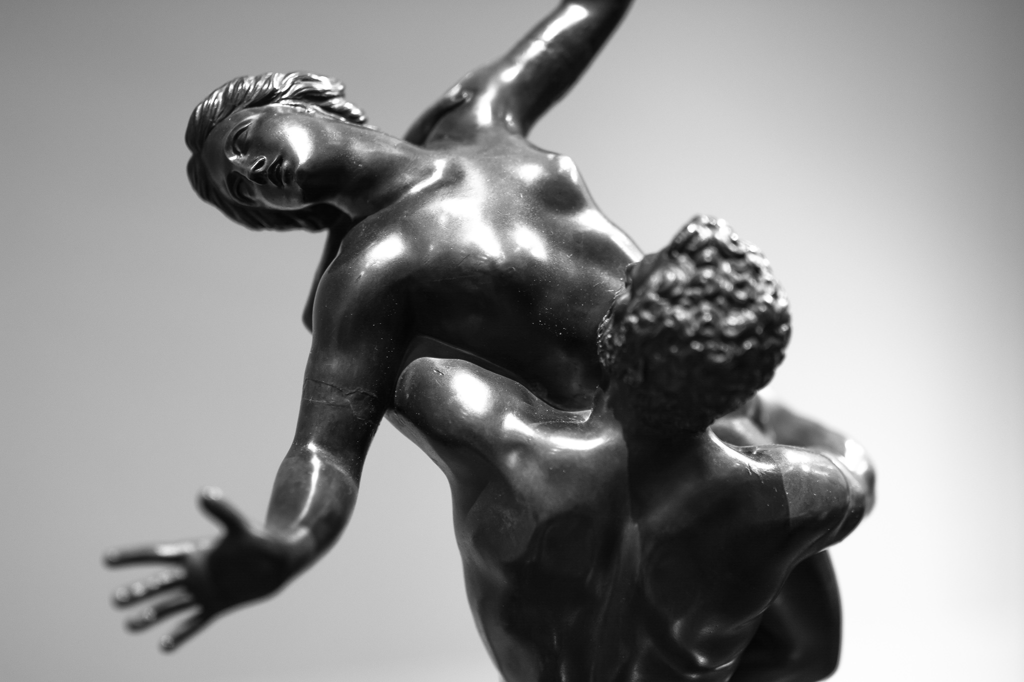 Bronze replica of Giambologna's sculpture, 'The Rape of the Sabina Women', originally carved in white marble approximately 4m high and located in Florence, Italy.<br> According to the legend, after Romulus has founded the city of Rome, women were sought among the people of the Sabines, who after opposing and trying to prevent it, were deceived and all their women were captured.